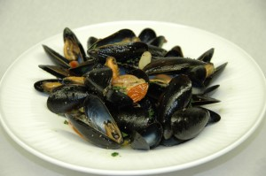 Mussels in a white wine broth spiked with black pepper