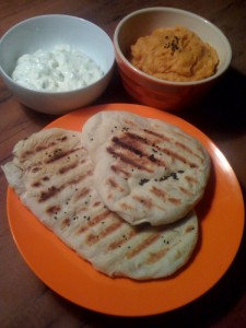 Homemade flatbread with nigella seeds and two dips: tzatziki and sweet potato/chickpea